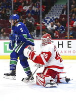 Vancouver Canucks' J.T Miller (9) stands in front of Detroit Red Wings goalie Jonathan Bernier (45) during the second period of an NHL hockey game Tuesday, Oct. 15, 2019, in Vancouver, British Columbia. (Ben Nelms/The Canadian Press via AP)