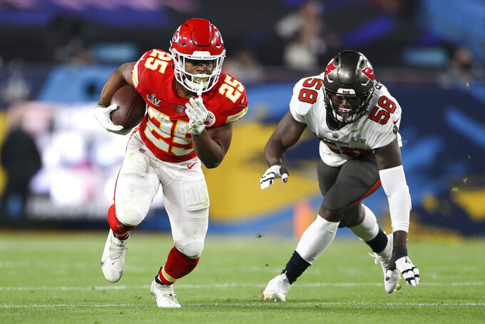 Kansas City Chiefs running back Clyde Edwards-Helaire (25) carries the ball in front of Tampa Bay Buccaneers outside linebacker Shaquil Barrett (58) during the NFL Super Bowl LV football game on Sunday, Feb. 7, 2021, in Tampa, Florida. (Ben Liebenberg/NFL)