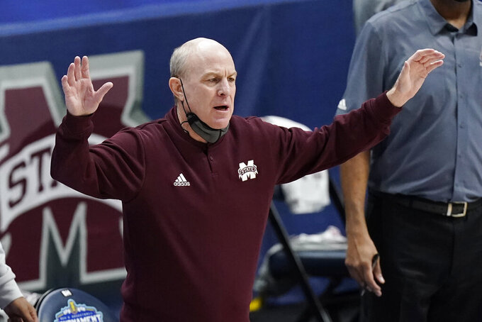 Mississippi State head coach Ben Howland watches the action in the first half of an NCAA college basketball game against Kentucky in the Southeastern Conference Tournament Thursday, March 11, 2021, in Nashville, Tenn. (AP Photo/Mark Humphrey)