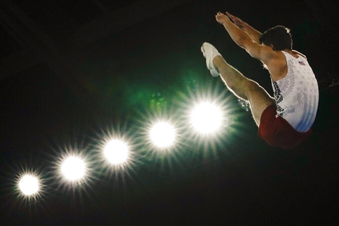 Aliaksei Shostak, of United States, competes in in the men's trampoline gymnastics qualifier at the 2020 Summer Olympics, Saturday, July 31, 2021, in Tokyo. (AP Photo/Ashley Landis)