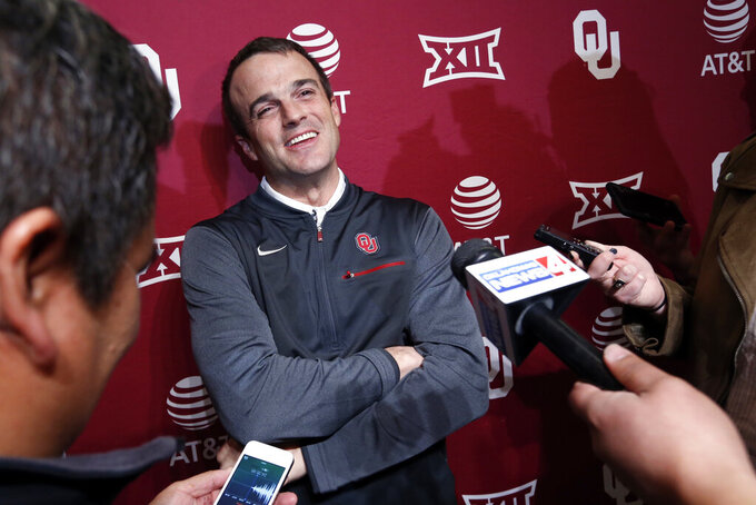 FILE - In this Jan. 26, 2018, file photo, Shane Beamer, an assistant football coach at Oklahoma, speaks during a news conference in Norman, Okla.  Beamer is returning to South Carolina, this time as head coach. A source close to the search told The Associated Press on Saturday night, Dec. 5, that Beamer will be hired and take over the program run the past five seasons by Will Muschamp. Muschamp was let go last month with three games remaining in the season. The person spoke to the AP on the condition of anonymity because South Carolina has not yet made the hire official. (Steve Sisney/The Oklahoman via AP, File)