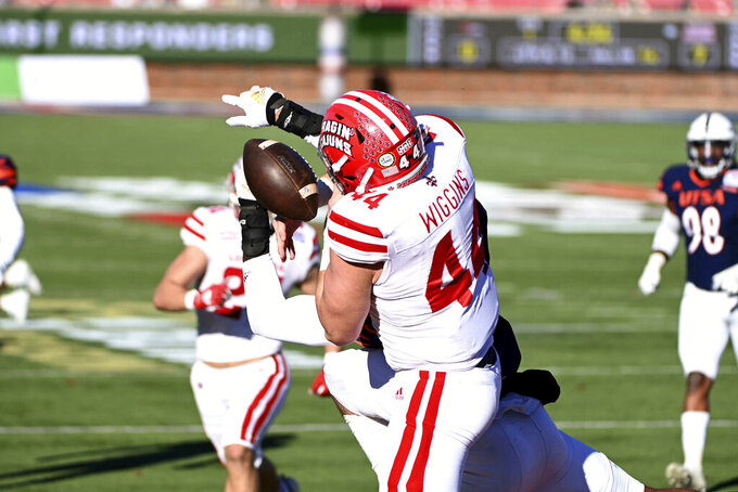 Louisiana-Lafayette linebacker Tanner Wiggins (44) can't hold on to a pass on a fake field goal in the first quarter during the First Responder Bowl NCAA college football game against UTSA in Dallas, Saturday, Dec. 26, 2020. (AP Photo/Matt Strasen)