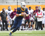 West Virginia quarterback Jarret Doege (2) looks to pass against Eastern Kentucky during an NCAA college football game on Saturday, Sept. 12, 2020, in Morgantown, W.Va.  (William Wotring/The Dominion-Post via AP)