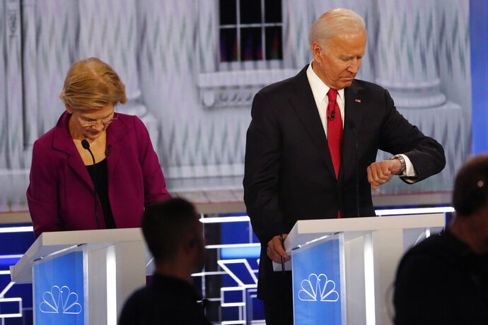 Democratic presidential candidate Sen. Elizabeth Warren, D-Mass., left, and Democratic presidential candidate former Vice President Joe Biden during a commercial break in a Democratic presidential primary debate, Wednesday, Nov. 20, 2019, in Atlanta. (AP Photo/John Bazemore)