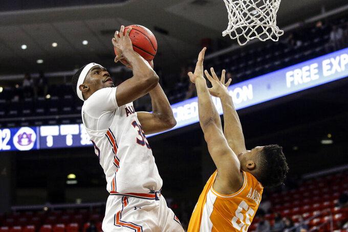 Auburn guard Devan Cambridge (35) puts up a shot over Tennessee forward E.J. Anosike (55) during the first half of an NCAA basketball game Saturday, Feb. 27, 2021, in Auburn, Ala. (AP Photo/Butch Dill)