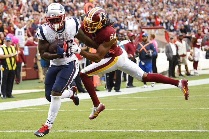 New England Patriots running back Sony Michel (26) scores a touchdown against Washington Redskins cornerback Josh Norman (24) during the second half of an NFL football game, Sunday, Oct. 6, 2019, in Washington. (AP Photo/Nick Wass)