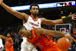 Virginia guard Braxton Key (2) blocks Virginia Tech guard Landers Nolley II (2) during the first half of an NCAA college basketball game in Charlottesville, Va., Saturday, Jan. 4, 2020. (AP Photo/Steve Helber)
