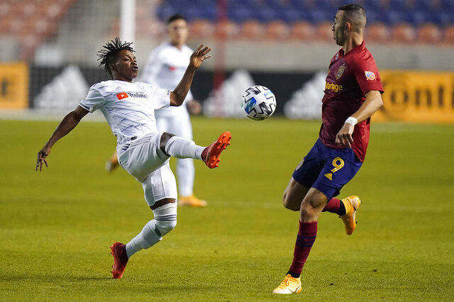 Los Angeles FC forward Latif Blessing, left, and Real Salt Lake forward Justin Meram (9) vie for the ball during the first half of an MLS soccer match Sunday, Oct. 4, 2020, in Sandy, Utah. (AP Photo/Rick Bowmer)