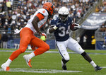 Connecticut running back Kevin Mensah (34) is pursued by Illinois defensive back Tony Adams (6) during the first half of an NCAA college football game, Saturday, Sept. 7, 2019, in East Hartford, Conn. (AP Photo/Jessica Hill)