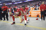 FILE - In this Sept. 12, 2016, file photo, San Francisco 49ers safety Eric Reid (35) and quarterback Colin Kaepernick (7) kneel during the national anthem before an NFL football game against the Los Angeles Rams in Santa Clara, Calif. When Colin Kaepernick took a knee during the national anthem to take a stand against police brutality, racial injustice and social inequality, he was vilified by people who considered it an offense against the country, the flag and the military. Nearly four years later, it seems more people are starting to side with Kaepernick's peaceful protest and now are calling out those who don't understand the intent behind his action.  (AP Photo/Marcio Jose Sanchez, File)
