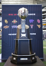 The Big 12 Conference trophy is displayed at the Big 12 Conference media days in Arlington, Texas, Monday, July 15, 2019. (AP Photo/David Kent)