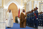 In this Wednesday, Nov. 27, 2019, photo released by Ministry of Presidential Affairs, Saudi Crown Prince Mohammed bin Salman, right, inspects the guard of honor next to Abu Dhabi Crown Prince Mohammed bin Zayed Al Nahyan at Qasr Al Watan in Abu Dhabi, United Arab Emirates. Saudi crown prince is in the United Arab Emirates for talks that are expected to focus on the war in Yemen and tensions with Iran. (Eissa Al Hammadi /Ministry of Presidential Affairs via AP)