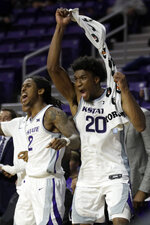 Kansas State guard Cartier Diarra (2) and forward Xavier Sneed (20) celebrate a 3-point basket while on the bench during the second half of the team's NCAA college basketball game against Monmouth in Manhattan, Kan., Wednesday, Nov. 13, 2019. Kansas State defeated Monmouth 73-54. (AP Photo/Orlin Wagner)