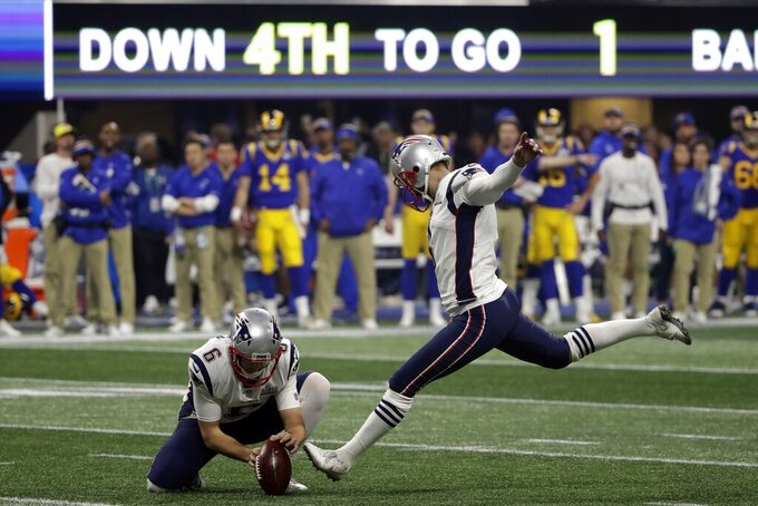 New England Patriots' Stephen Gostkowski (3) kicks a field goal as Ryan Allen (6) holds, during the second half of the NFL Super Bowl 53 football game against the Los Angeles Rams, Sunday, Feb. 3, 2019, in Atlanta. (AP Photo/Matt Rourke)