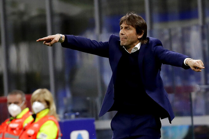 Inter Milan's head coach Antonio Conte gives instructions to his players during a Serie A soccer match between Inter Milan and Roma at the San Siro stadium in Milan, Italy, Wednesday, May 12, 2021. (AP Photo/Luca Bruno)