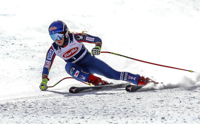 FILE - In this Nov. 15, 2017, file photo, Mikaela Shiffrin gets low in her turn during a downhill training run at Copper Mountain, Colo. Shiffrin and the U.S. women's ski team, along with the men's Europa squad, returned to snow for a June camp in Copper Mountain, Colorado. It was a chance to go fast on the slopes again after the season abruptly ended in March due to the coronavirus pandemic. (Chris Dillmann/Vail Daily via AP, File)