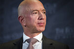 """FILE- In this Sept. 13, 2018, file photo Jeff Bezos, Amazon founder and CEO, speaks at The Economic Club of Washington's Milestone Celebration in Washington. An attorney for the head of the National Enquirer's parent company says the tabloid didn't commit extortion or blackmail by threatening to publish Bezos' explicit photos. Elkan Abramowitz represents American Media Inc. CEO David Pecker. He defended the tabloid's practice as a """"negotiation"""" in an interview Sunday, with ABC News.(AP Photo/Cliff Owen, File)"""