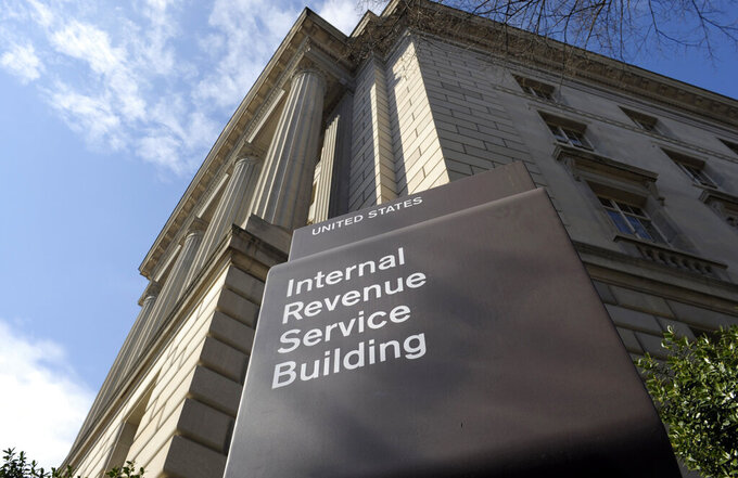 FILE - In this photo March 22, 2013 file photo, the exterior of the Internal Revenue Service (IRS) building in Washington. A complaint filed with the IRS alleges that a conservative group is violating its nonpartisan and nonprofit status by using a voter data system linked to the Republican party. The complaint is against the American Legislative Exchange Council. (AP Photo/Susan Walsh, File)