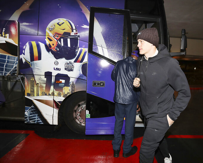 LSU quarterback Joe Burrow, the 2019 Heisman Trophy winner, arrives with his team for the CFP Peach Bowl football game on Sunday, Dec. 22, 2019, in Atlanta. (Curtis Compton/Atlanta Journal-Constitution via AP)