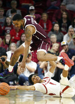 Arkansas guard Isaiah Joe (1) and Texas A&M guard TJ Starks (2) go after the ball during the second half of an NCAA college basketball game, Saturday, Feb. 23, 2019, in Fayetteville, Ark. (AP Photo/Michael Woods)