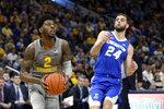 Marquette's Sacar Anim (2) drives to the basket against Creighton's Mitch Ballock (24) during the first half of an NCAA college basketball game Tuesday, Feb. 18, 2020, in Milwaukee. (AP Photo/Aaron Gash)