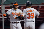 Baltimore Orioles' Renato Nunez (39) celebrates his solo home run with DJ Stewart during the sixth inning of the team's baseball game against the Boston Red Sox, Tuesday, Sept. 22, 2020, in Boston. (AP Photo/Michael Dwyer)