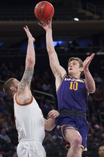 Lipscomb guard Jake Wolfe (10) goes to the basket against Texas forward Dylan Osetkowski during the second half of an NCAA college basketball game for the NIT championship Thursday, April 4, 2019, at Madison Square Garden in New York. Texas won 81-66. (AP Photo/Mary Altaffer)