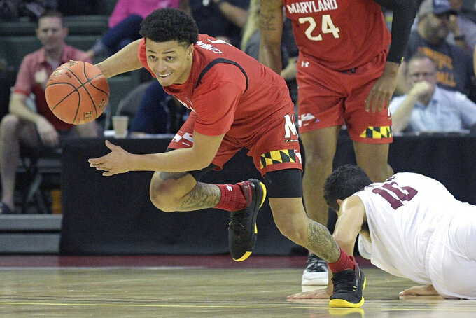 Maryland guard Anthony Cowan Jr. (1) steals the ball from Harvard guard Noah Kirkwood (10) during the second half of an NCAA college basketball game Friday, Nov. 29, 2019, in Lake Buena Vista, Fla. (AP Photo/Phelan M. Ebenhack)