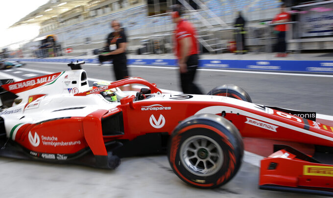 Formula 2 driver Mick Schumacher steers his Prema racing team car during the Formula 2 qualifying session at the Bahrain International Circuit in Sakhir, Bahrain, Friday, March 29, 2019. It promises to be a whirlwind few days for the son of Formula One great Michael Schumacher, as he makes his F2 debut this weekend and then drives in his first F1 test for Ferrari on Tuesday. (AP Photo/Luca Bruno)
