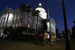 The lights of the Capitol dome shine as lawmakers work into the night in Sacramento, Calif., Friday, Sept. 10, 2021. Lawmakers have until midnight to finish work on the 2021 legislative session. (AP Photo/Rich Pedroncelli)