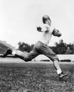 FILE - In this 1934 file photo, University of Chicago halfback Jay Berwanger is shown in the action pose that served as the model for the Heisman Trophy. In the early days of the NFL, college football was king and playing the game professionally was not necessarily something players aspired to do. (AP Photo/File)
