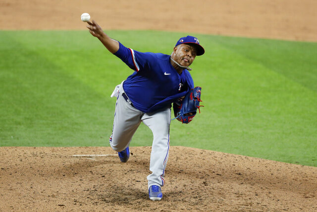 Texas Rangers pitcher Edinson Volquez throws to the plate in an intrasquad game during baseball practice at Globe Life Field in Arlington, Texas, Friday, July 10, 2020. (AP Photo/Tony Gutierrez)