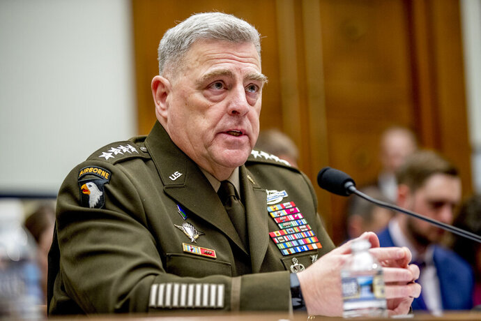 "FILE - In this Feb. 26, 2020 file photo, Joint Chiefs of Staff Chairman Gen. Mark Milley speaks at a House Armed Services Committee hearing on Capitol Hill in Washington. The top U.S. military officer is telling Congress that the U.S. armed forces will have no role in carrying out the election process or resolving a disputed vote. The comments from Gen. Mark Milley, chairman of the Joint Chiefs of Staff, underscore the extraordinary political environment in America, where the president has declared without evidence that the expected surge in mail-in ballots will make the vote  ""inaccurate and fraudulent,"" (AP Photo/Andrew Harnik)"