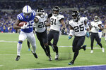 Indianapolis Colts running back Marlon Mack (25) runs for a touchdown past Jacksonville Jaguars' Jarrod Wilson (26) during the first half of an NFL football game, Sunday, Nov. 17, 2019, in Indianapolis. (AP Photo/Michael Conroy)