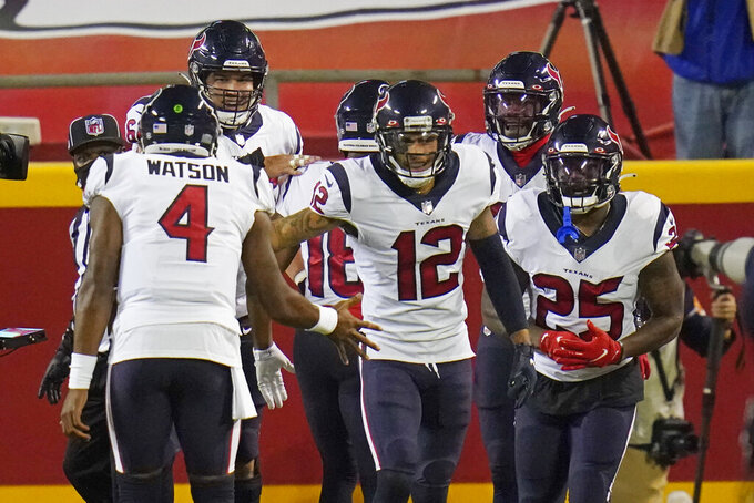Houston Texans quarterback Deshaun Watson (4) celebrates with wide receiver Kenny Stills (12) and running back Duke Johnson (25) after the Texans scored a touchdown against the Kansas City Chiefs in the first half of an NFL football game Thursday, Sept. 10, 2020, in Kansas City, Mo. (AP Photo/Jeff Roberson)