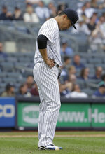 New York Yankees starting pitcher Masahiro Tanaka reacts after giving up a grand slam during the fourth inning of a baseball game against the Chicago White Sox at Yankee Stadium, Sunday, April 14, 2019, in New York. (AP Photo/Seth Wenig)