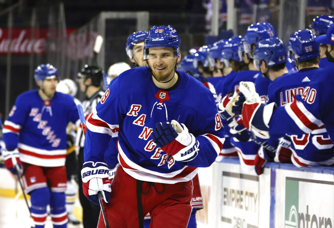 New York Rangers' Pavel Buchnevich (89) smiles after his goal against against the Pittsburgh Penguins during the third period of an NHL hockey game Tuesday, April 6, 2021, in New York. (Bruce Bennett/Pool Photo via AP)