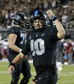 Central Florida quarterback McKenzie Milton celebrates after his 1-yard touchdown run against Temple during the first half of an NCAA college football game, Thursday, Nov. 1, 2018, in Orlando, Fla. (AP Photo/John Raoux)