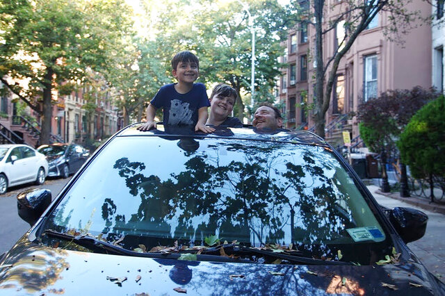 AP journalist Mark Kennedy poses with his kids popping out of the sunroof of his first car, a 2015 Mazda CX-5, in the Brooklyn borough of New York. The pandemic has altered so much in America in ways great and small. The subways, buses and ride sharing platforms are trips not for the nervous and car sharing services aren't practical or economical for long-term rentals. (Lisa Tolin via AP)