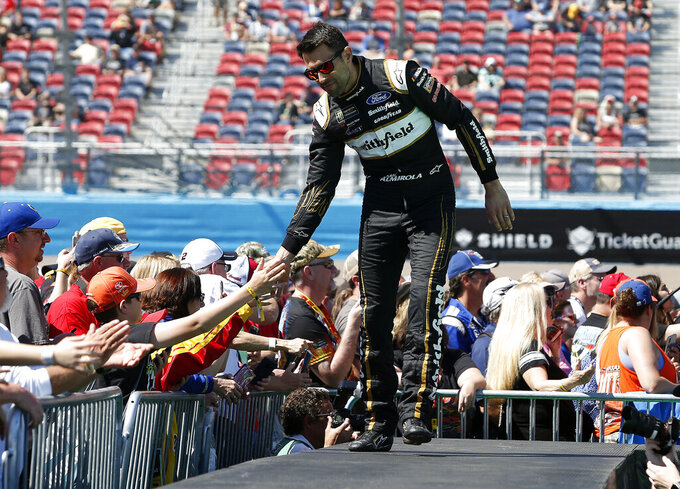 Aric Almirola is greeted by fans during driver introductions prior to the start of the NASCAR Cup Series auto race at ISM Raceway, Sunday, March 10, 2019, in Avondale, Ariz. (AP Photo/Ralph Freso)