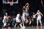 Brooklyn Nets forward Nicolas Claxton (33) goes to the basket past Philadelphia 76ers forwards James Ennis III (11),  Jonah Bolden (43) and Tobias Harris (12) during the first half of an NBA basketball game, Monday, Jan. 20, 2020, in New York. (AP Photo/Mary Altaffer)