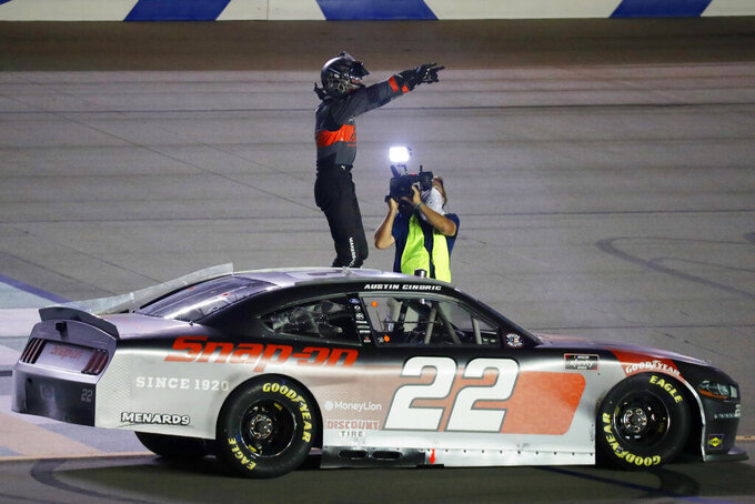 Austin Cindric (22) celebrates winning the NASCAR Xfinity Series auto race, Thursday, July 9, 2020, in Sparta, Ky. (AP Photo/Mark Humphrey)
