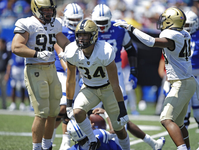 Army linebacker Andre Carter II (34) celebrates after sacking Georgia State quarterback Cornelious Brown IV (4) during the first quarter of an NCAA football game Saturday, Sept. 4, 2021, in Atlanta. (AP Photo/Ben Margot)