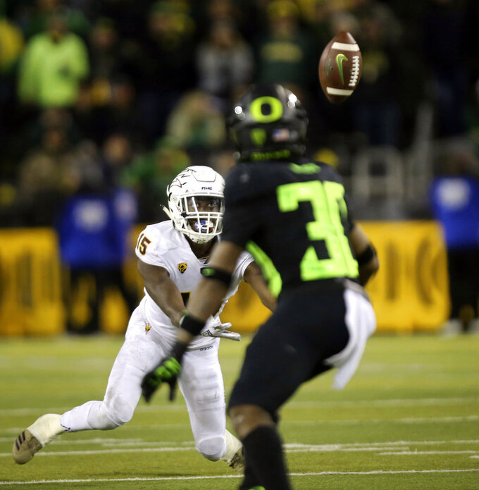Arizona State's Cam Phillips dives for a tipped pass in the fourth quarter against Oregon in an NCAA college football game Saturday, Nov. 17, 2018, in Eugene, Ore. (AP Photo/Chris Pietsch)