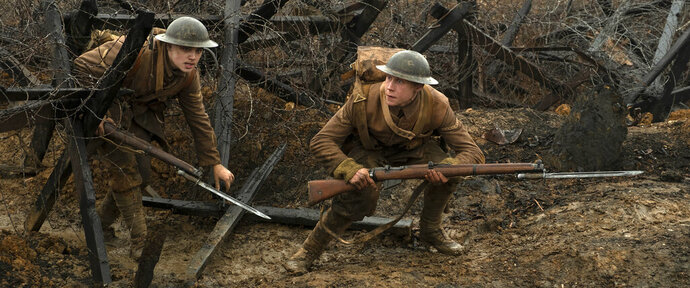 This image released by Universal Pictures shows Dean-Charles Chapman, left, and George MacKay in a scene from