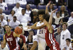Washington's RaeQuan Battle (21) passes the ball as Washington State's Jervae Robinson (1) and CJ Elleby defend during the second half of an NCAA college basketball game Friday, Feb. 28, 2020, in Seattle. Washington State won 78-74. (AP Photo/Elaine Thompson)