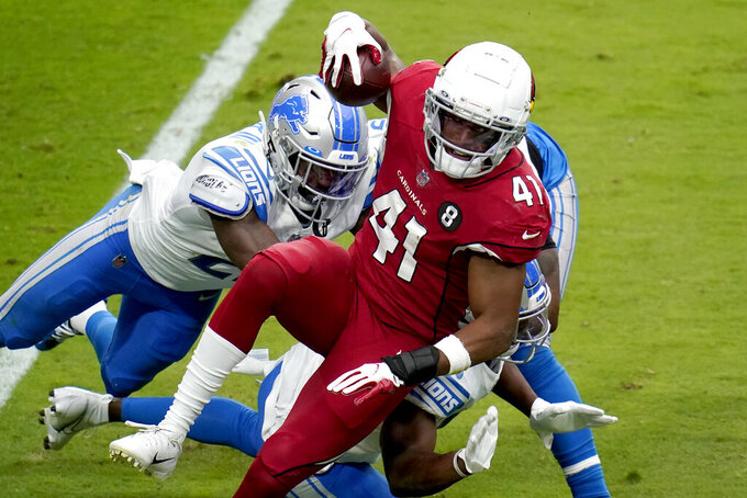 Arizona Cardinals running back Kenyan Drake (41) is hit during the first half of an NFL football game against the Detroit Lions, Sunday, Sept. 27, 2020, in Glendale, Ariz. (AP Photo/Ross D. Franklin)