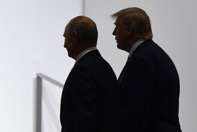 "FILE - In this June 28, 2019, file photo, President Donald Trump and Russian President Vladimir Putin walk to participate in a group photo at the G20 summit in Osaka, Japan. Russia says it will withdraw from an international treaty allowing observation flights over military facilities following the U.S. exit from the pact. Russia's Foreign Ministry said in a statement Friday, Jan. 15, 2021 that the U.S. withdrawal from the Open Skies Treaty last year ""significantly upended the balance of interests of signatory states,"" adding that Moscow's proposals to keep the treaty alive after the U.S. exit have been cold-shouldered by Washington's allies. (AP Photo/Susan Walsh, File)"