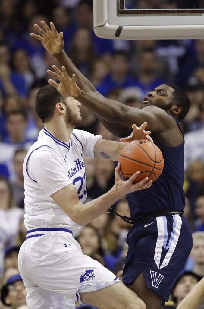 Villanova forward Eric Paschall (4) defends Seton Hall forward Sandro Mamukelashvili (23) during the first half of an NCAA college basketball game, Saturday, March 9, 2019, in Newark, N.J. (AP Photo/Kathy Willens)