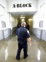 In this Feb. 26, 2015, file photo, a Department of Corrections Officer walks to the Wasatch A-East block during a media tour, at the Utah State Correctional Facility in Draper, Utah. Authorities say Utah is seeing a dramatic surge in their prison population as more people are convicted on new crimes and drug violations, KSL TV reports. (AP Photo/Rick Bowmer, Pool, File)